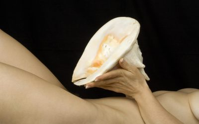 Naked Woman is Holding a Large Sea-Shell